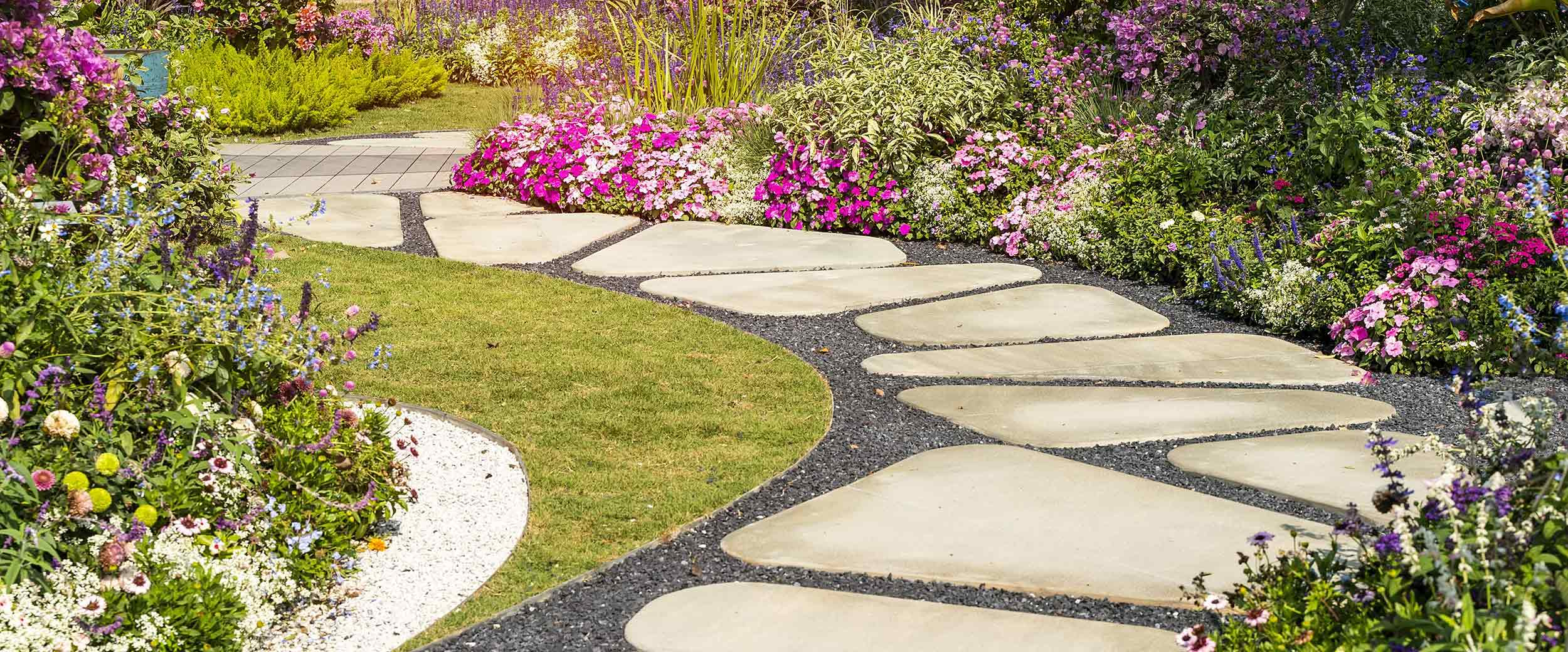 Flagstone path through garden by Finer Lawn & Landscaping