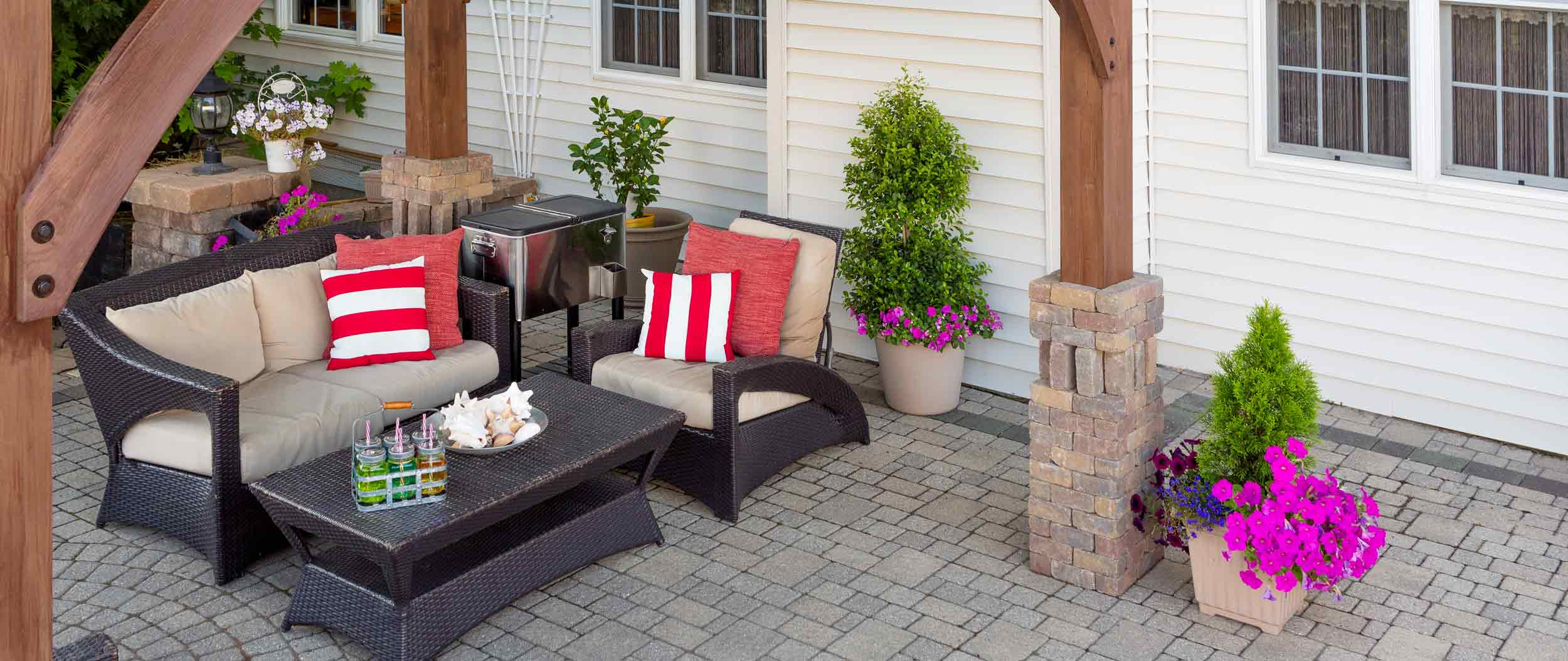 Paver patio with pergola by Finer Lawn & Landscaping