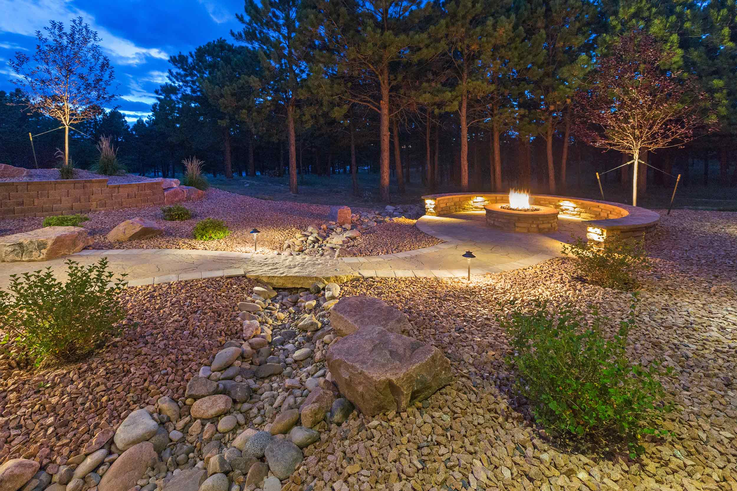 Landscaping and Hardscaping - Firepit with bench seating.