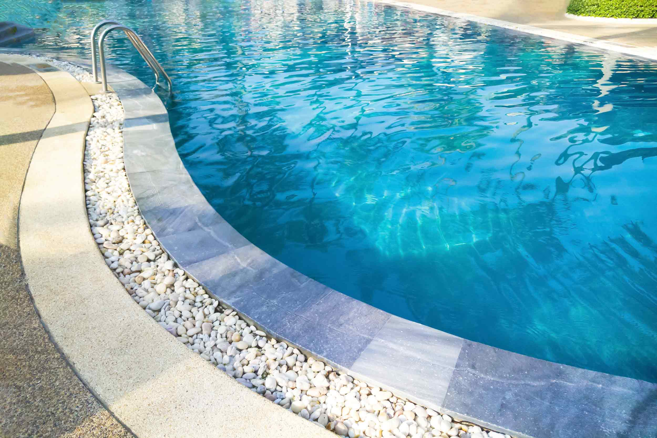 Pool Decking - Paver decking with landscaping rock.